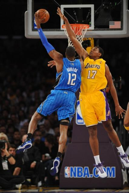 Andrew Bynum tries to block Dwight Howard_s shot