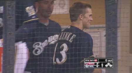 Zack Greinke smiles after homering against Washington