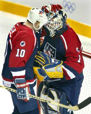 Dunham, in team USA jersey, wearing Preds gloves and Pads