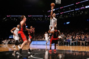 Toronto Raptors Kyle Lowry take a charge from Brooklyn Nets Deron Willams