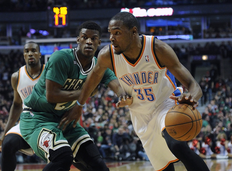 okc thunder kevin durant dribbles past chicago bulls jimmy butler