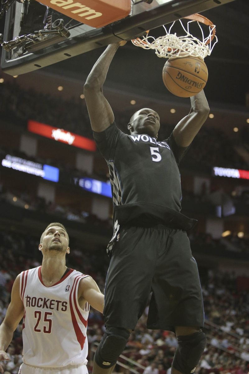 minnesota timberwolves gorgui dieng dunks against houston