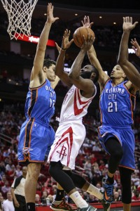 houston rocket james harden shoots over oklahoma city's steven adams and andre roberson