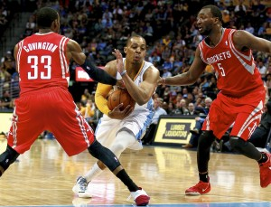 randy foye dribbles between jordan hamilton & robert covington