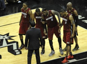 lebron james is helped off the court 2014 nba finals game 1