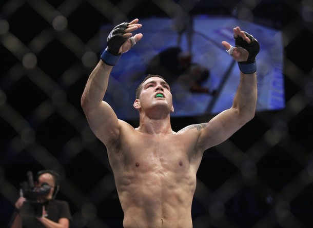 chris weidman celebrates munoz victory