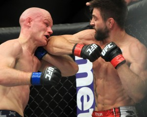 carlos condit elbows martin kampmann at ufc fight night: condit vs kampmann 2