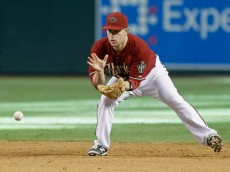 PHOENIX, AZ - AUGUST 31:  Aaron Hill #2 of the Arizona Diamondbacks fields a ground ball against the Colorado Rockies during the ninth inning of a MLB game at Chase Field on August 31, 2014 in Phoenix, Arizona.  (Photo by Ralph Freso/Getty Images)