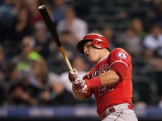 DENVER, CO - JULY 7:  Mike Trout #27 of the Los Angeles Angels of Anaheim singles against the Colorado Rockies in the ninth inning of a game at Coors Field on July 7, 2015 in Denver, Colorado.  (Photo by Dustin Bradford/Getty Images)