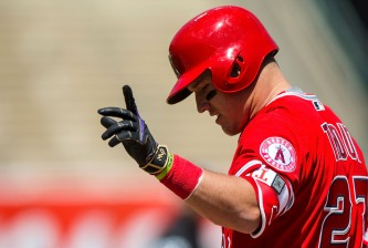 OAKLAND, CA - APRIL 13:  Mike Trout #27 of the Los Angeles Angels of Anaheim celebrates after hitting a single while wearing a black and gold version of Nike batting gloves in honor of Kobe Bryant's retirement during the third inning against the Oakland Athletics at the Coliseum on April 13, 2016 in Oakland, California. The Los Angeles Angels of Anaheim defeated the Oakland Athletics 5-1. (Photo by Jason O. Watson/Getty Images)