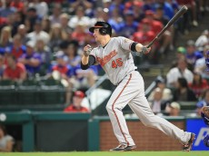 ARLINGTON, TX - APRIL 16:  Mark Trumbo #45 of the Baltimore Orioles at Globe Life Park in Arlington on April 16, 2016 in Arlington, Texas.  (Photo by Ronald Martinez/Getty Images)
