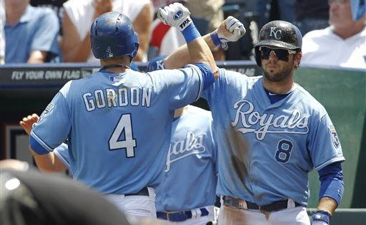Kansas City Royals' Alex Gordon (4) is congratulated by teammate Mike Moustakas (8) after hitting a home run off of Boston red sox pitcher John Lackey in the third inning of a baseball game at Kauffman Stadium in Kansas City, Mo