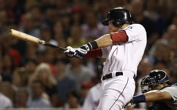 Will Middlebrooks #16 of the Boston Red Sox follows through on a two-run single against the Detroit Tigers during the fifth inning at Fenway Park on September 3, 2013 in Boston, Massachusetts.