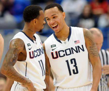 University of Connecticut Huskies guard Ryan Boatright, left and guard Shabazz Napier share a laugh .