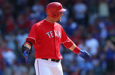 A.J. Pierzynski #12 of the Texas Rangers reacts after hitting a double against the Los Angeles Angels in the 5th inning at Rangers Ballpark in Arlington on September 29, 2013 in Arlington, Texas.