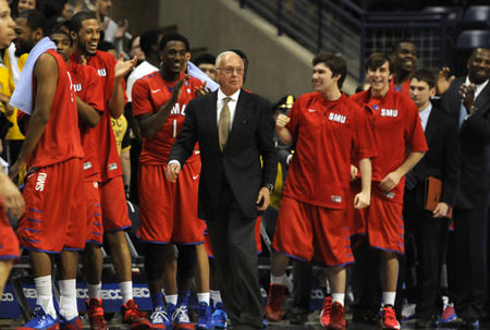 SMU celebrates its win over UConn with coach Larry Brown.