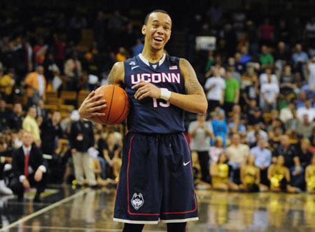 UConn guard Shabazz Napier laughs at the end of the game after the Huskies beat the UCF Knights 75-55 at UCF Arena.