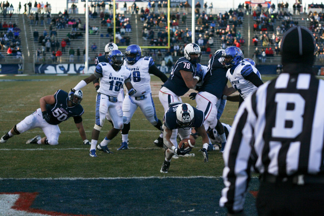 #43 Lyle McCombs of UConn dives in for a touchdown against the Memphis Tigers at Rentschler Field.