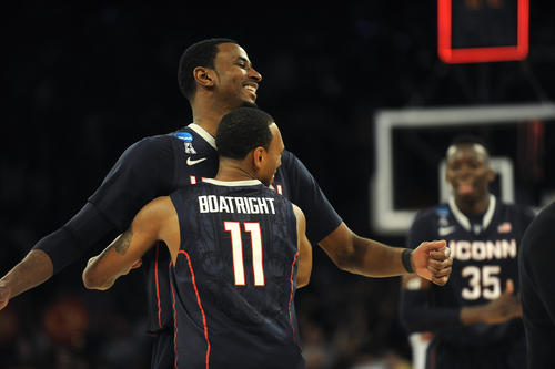 UConn's DeAndre Daniels is hugged by teammate Ryan Boatright after defeating Iowa State in an NCAA East Regional semifinal game at Madison Square Garden Friday night.