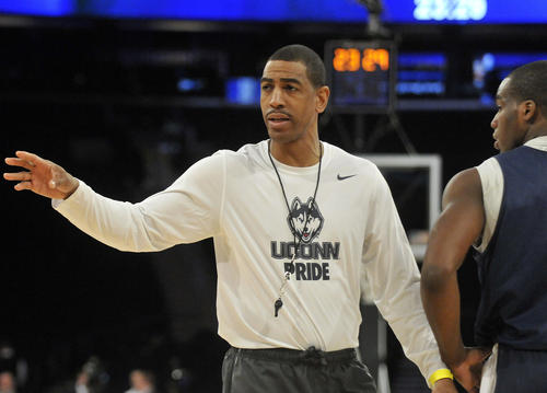 Coach Kevin Ollie speaks to his team during practice Thursday at Madison Square Garden ahead of Friday night's NCAA East Regional semifinal game against Iowa State.