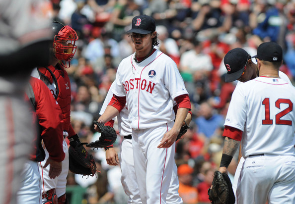 Clay Buchholz #11of the Boston Red Sox reacts after getting taken out in the third inning after giving up six runs against the Baltimore Orioles at Fenway Park April 21, 2014 in Boston, Massachusetts.