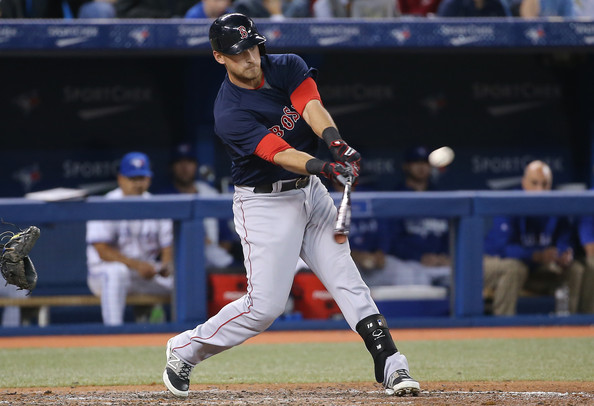 Will Middlebrooks #16 of the Boston Red Sox hits an RBI double in the sixth inning during MLB game action against the Toronto Blue Jays on April 25, 2014 at Rogers Centre in Toronto, Ontario, Canada.