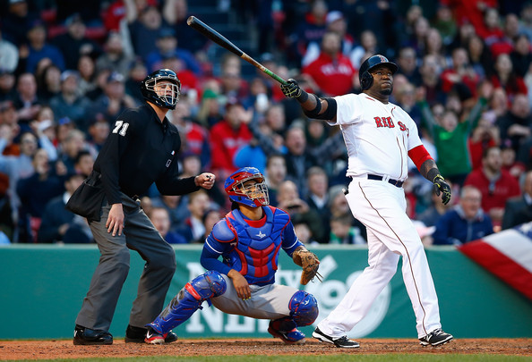 David Ortiz #34 of the Boston Red Sox watches the ball after hitting a three-run home run in the 8th inning against the Texas Rangers at Fenway Park on April 9, 2014 in Boston, Massachusetts.
