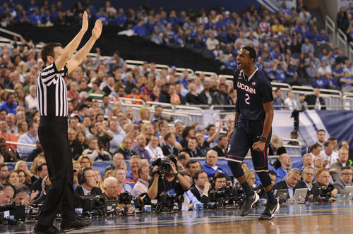 UConn forward DeAndre Daniels reacts after hitting a three-point shot during the first half.