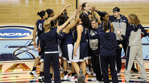 The UConn Huskies huddle at midcourt Saturday during open practice for the 2014 NCAA Women's Final Four.