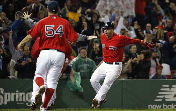 A.J. Pierzynski #40 of the Boston Red Sox is greeted by teammates after his game-winning RBI triple during the tenth inning of their 3-2 win over the Tampa Bay Rays at Fenway Park on May 30, 2014 in Boston, Massachusetts.