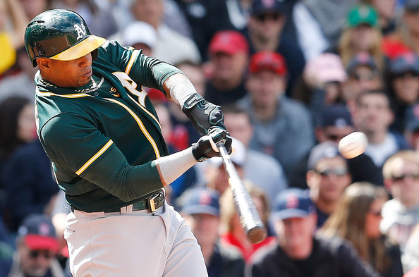 Yoenis Cespedes #52 of the Oakland Athletics knocks in the go-ahead run in the sixth inning against the Boston Red Sox in the third inning at Fenway Park on May 4, 2014 in Boston, Massachusetts.