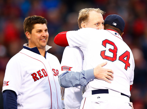 Former Boston Red Sox player Curt Schilling hugs David Ortiz #34 of the Boston Red Sox while being honored prior to the game between the Boston Red Sox and Atlanta Braves at Fenway Park on May 28, 2014 in Boston, Massachusetts. The pregame ceremony commemorated the 2004 World Series Championship Boston Red Sox team.