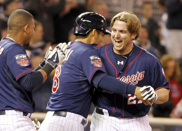 Chris Parmelee #27 of the Minnesota Twins is congratulated by teammates after his walk off two-run home run in the ninth inning to beat the Boston Red Sox 8-6 during MLB game action on May 13, 2014 at Target Field in Minneapolis, Minnesota.