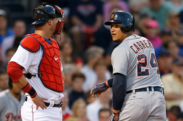 Miguel Cabrera #24 of the Detroit Tigers looks at A.J. Pierzynski #40 of the Boston Red Sox, after hitting a home run in the third inning at Fenway Park on May 17, 2014 in Boston, Massachusetts.