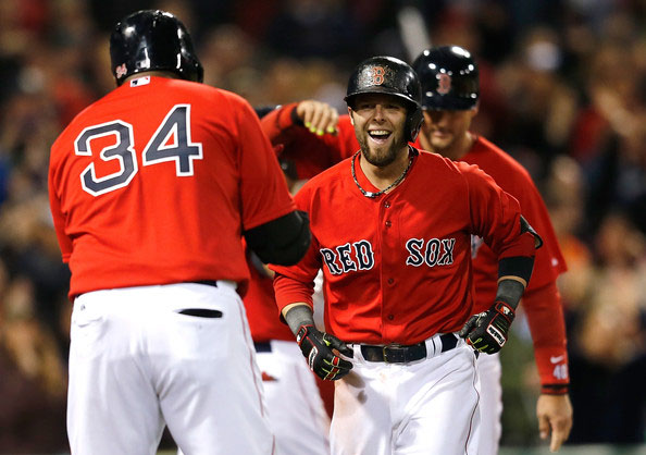 Dustin Pedroia #15 of the Boston Red Sox celebrates with David Ortiz #34 after he hit grand slam home run in the sixth inning against the Oakland Athletics at Fenway Park on May 2, 2014 in Boston, Massachusetts.