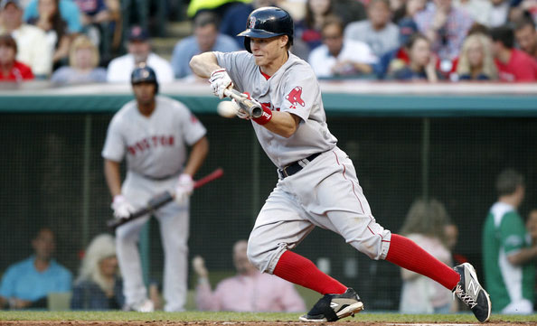 Brock Holt #26 of the Boston Red Sox attempts a bunt in the fifth inning against the Cleveland Indians on June 3, 2014 at Progressive Field in Cleveland, Ohio.