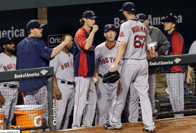 Teammates greet Boston Red Sox starting pitcher Brandon Workman (67) as he walks off the field at the end of the sixth inning of a baseball game against the Baltimore Orioles, Tuesday, June 10, 2014, in Baltimore.