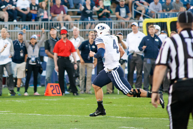 BYU QB Taysom Hill scores on a seven yard touchdown run in the first quarter against the UConn Huskies at Rentschler Field in East Hartford, CT on August 29, 2014.