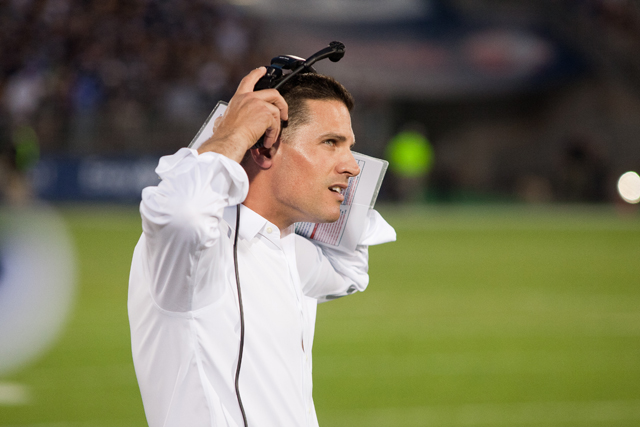 UConn head coach Bob Diaco looks up at a replay during the first quarter against the BYU Cougars on August 29, 2014 at Rentschler Field in East Hartford, CT.