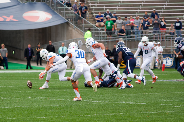 Boise State LB #20 Tanner Vallejo scoops up an Arkeel Newsome fumble and returns it for a touchdown against the UConn Huskies at Rentschler Field on September 13, 2014.
