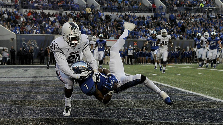 UConn's Jamar Summers takes down Keiwone Malone of Memphis in the end zone as the Tigers took a 13-0 lead late in the second quarter.