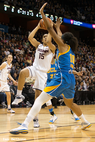 UConn G/F Gabby Williams (15) goes up strong for a layup as UCLA F Kacey Swain (10) tries to defend in the first half at Mohegan Sun Arena in Uncasville, CT.
