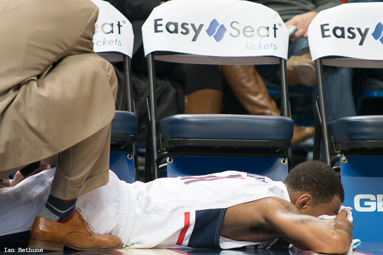 UConn G Ryan Boatright (11) has his thigh worked on after being kneed there late in the first half against Temple at the XL Center in Hartford, CT.