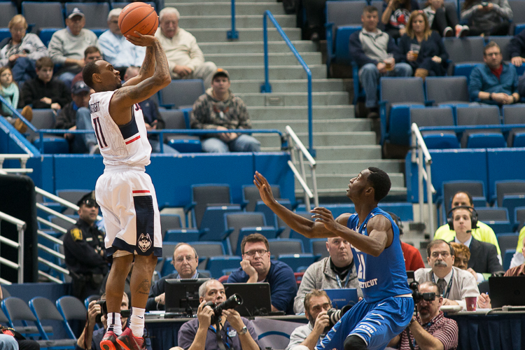 UConn G Ryan Boatright (11) shoots a three-pointer late in the second half against Central Connecticut at the XL Center in Hartford, CT.