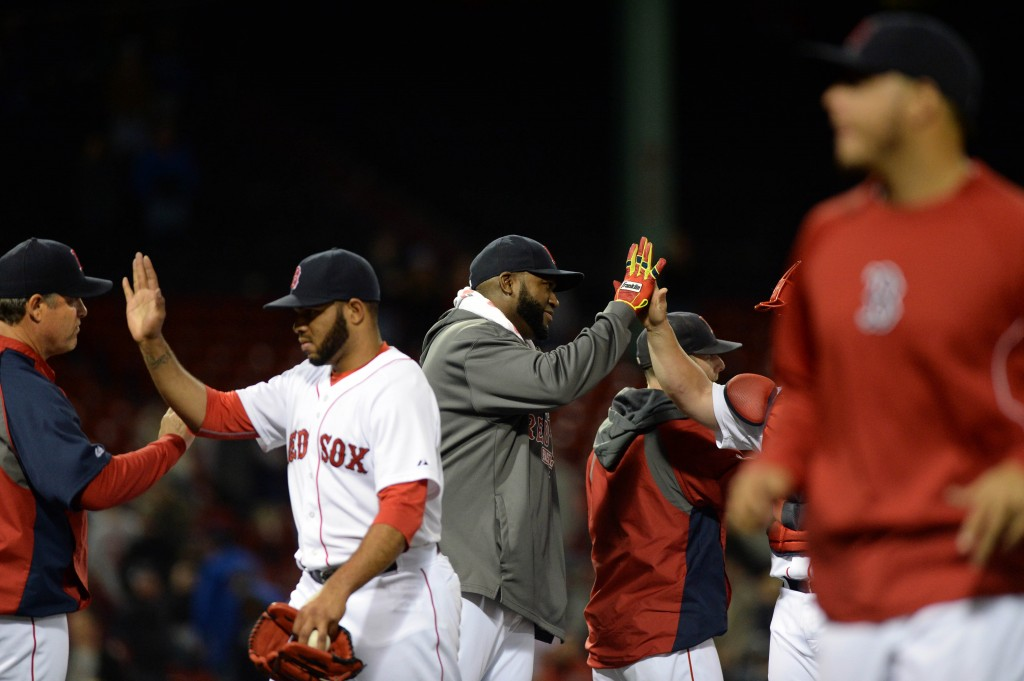 BOSTON, MA - SEPTEMBER 24:  David Ortiz #34 of the Boston Red Sox slaps high fives with teamate after beating the Tampa Bay Rays at Fenway Park on September 24, 2014 in Boston, Massachusetts. The Red Sox won the game 11-3. (Photo by Darren McCollester/Getty Images)