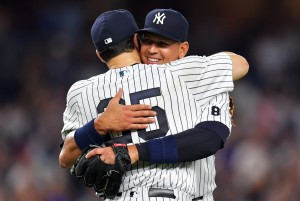 NEW YORK, NY - AUGUST 12: Alex Rodriguez #13 of the New York Yankees gets a hug from team mate Mark Teixeira #25 in the ninth inning against the Tampa Bay Rays at Yankee Stadium on August 12, 2016 in New York City. (Photo by Drew Hallowell/Getty Images)